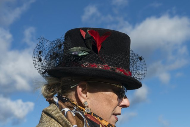 A woman wears a traditional hat at the Far Hills Race Day at Moorland Farms in Far Hills, New Jersey, October 17, 2015. (Photo by Stephanie Keith/Reuters)