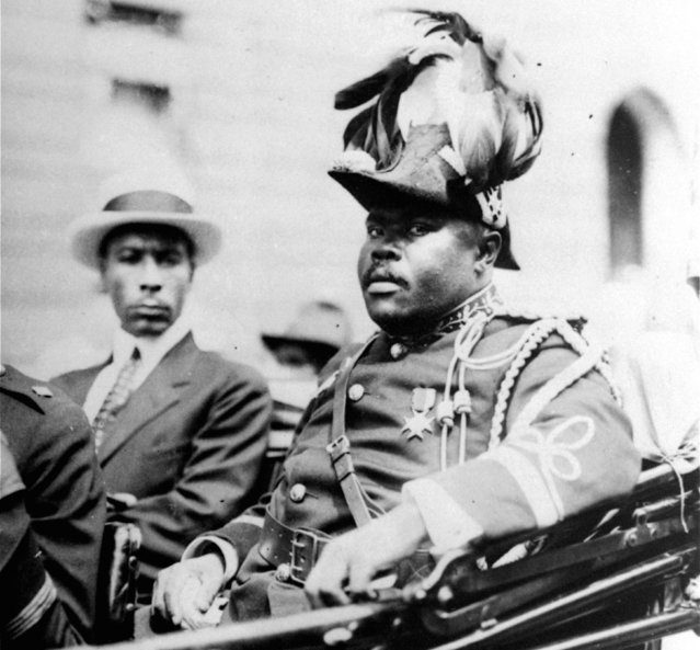"""In this August 1922 file photo, Marcus Garvey is shown in a military uniform as the """"Provisional President of Africa"""" during a parade on the opening day of the annual Convention of the Negro Peoples of the World along Lenox Avenue in Harlem borough of New York. The son ofMarcus Garvey on August 17, 2016, said his father's 129th birthday marked the perfect day to begin a public push for a presidential pardon to exonerate Garvey for an unjust conviction. Dr. Julius W. Garvey wants President Barack Obama to clear his father's name from a mail fraud conviction that caused Marcus Garvey to be deported from the United States to his native Jamaica. (Photo by AP Photo)"""
