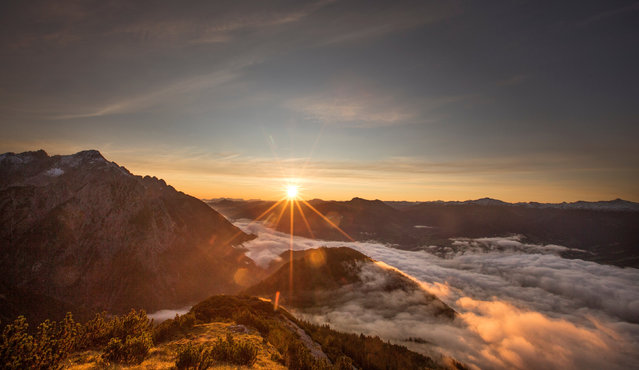 The sun rises over mountain summits in the Austrian village of Absam, Austria,  September 13, 2017. (Photo by Dominic Ebenbichler/Reuters)