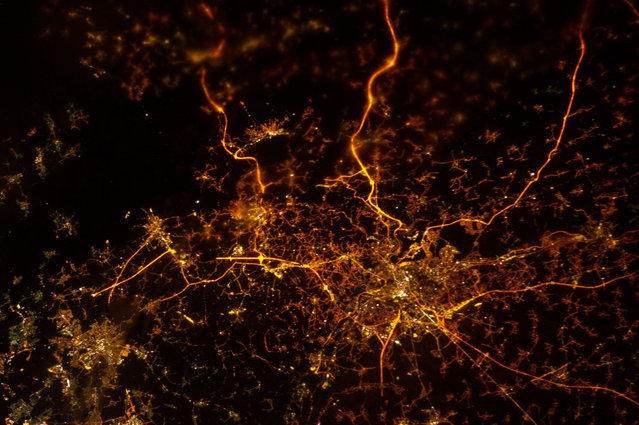 A nighttime view of Liege, Belgium, photographed by an Expedition 34 crew member on December 8, 2012. The brightly lit core of the Liege urban area appears to lie at the center of a network of roadways extending outwards into the rural, and relatively dark, Belgium countryside. For a sense of scale the distance from left to right is approximately 70 kilometers. The image was taken using the European Space Agency's Nodding mechanism, also known as the NightPod. NightPod is an electro-mechanical mount system designed to compensate digital cameras for the motion of the space station relative to Earth. The primary mission goal was to take high-resolution, long exposure digital imagery of Earth from the station's Cupola, particularly cities at night. (Photo by NASA/The Atlantic)