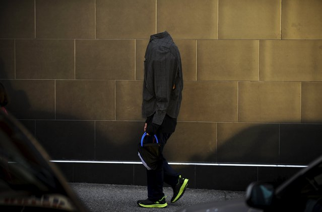 A boy walks during Halloween celebrations in La Fresneda, northern Spain, October 31, 2015. (Photo by Eloy Alonso/Reuters)