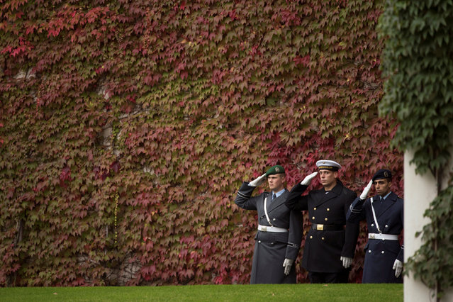 Soldiers of the German armed forces Bundeswehr salute during a welcome by German Chancellor Angela Merkel of Chad President Idriss Deby with military honour at the Chancellery in Berlin, Germany October 12, 2016. (Photo by Stefanie Loos/Reuters)