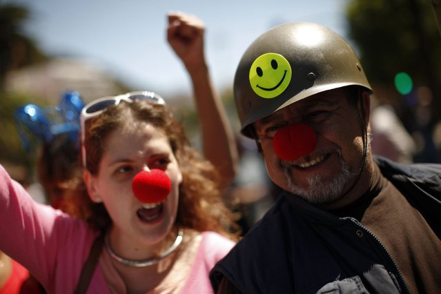 Protesters take part in a May Day demonstration on Labour Day in Malaga, southern Spain May 1, 2013. Workers hit by lower living standards and record high unemployment staged May Day protests across Europe on Wednesday, hoping to persuade euro zone governments of the case for easing austerity measures and boosting growth. The Spanish economy has shrunk for seven consecutive quarters, and unemployment stands at a record 27 percent. (Photo by Jon Nazca/Reuters)