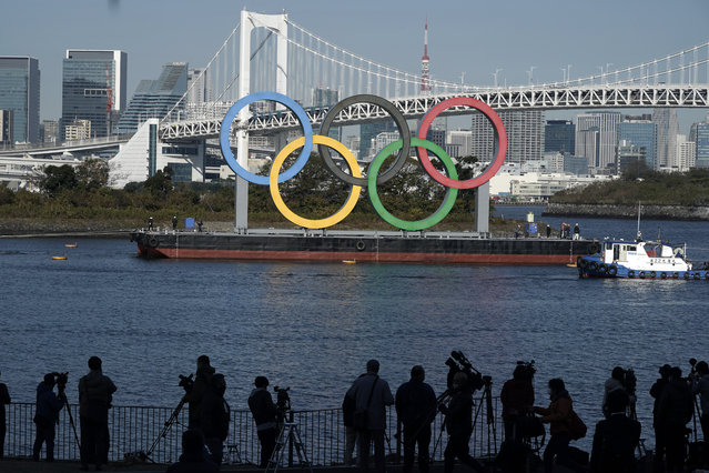 The Olympic Symbol is reinstalled after it was taken down for maintenance ahead of the postponed Tokyo 2020 Olympics in the Odaiba section Tuesday, December 1, 2020, in Tokyo. (Photo by Eugene Hoshiko/AP Photo)