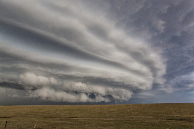 A supercell advances over the priaires in the east of the state, on September 22, 2014, in Colorado. (Photo by Roger Hill/Barcroft Media)