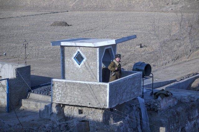 A solider keeps watch, Feburary 2012. (Eric Testroete)