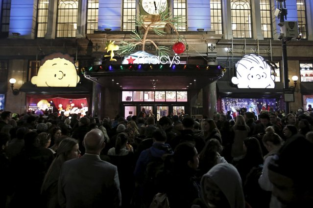 Shoppers wait to enter Macy's Herald Square store during the early opening of the Black Friday sales in the Manhattan borough of New York, November 26, 2015. (Photo by Andrew Kelly/Reuters)