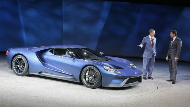 Ford Motor Co., Executive Chairman Bill Ford, left, and President and COO Mark Fields stand next to the new Ford GT during the North American International Auto Show, Monday, January 12, 2015 in Detroit. (Photo by Carlos Osorio/AP Photo)