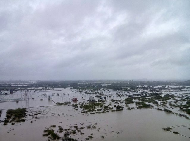Flooded areas are pictured on the outskirts of Chennai, India, December 2, 2015. The heaviest rainfall in over a century has caused massive flooding across the southern Indian state of Tamil Nadu, driving thousands from their homes, shutting auto factories and paralysing the airport in the state capital Chennai. (Photo by Reuters/Stringer)