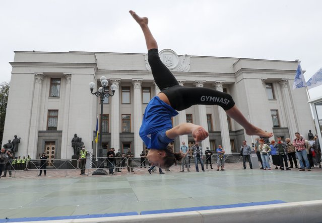 Students of Kiev's Olympic College perform during a rally in front of the Parliament building in Kiev, Ukraine, 15 September 2020. Students were protesting against the reorganization of the college, at risk of being closed, and the land where it rises which could end up for sale along with the facility's stadium. (Photo by Sergey Dolzhenko/EPA/EFE)
