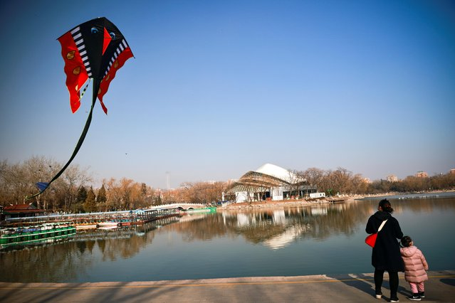 A kite flies in a park ahead of Lunar New Year celebrations following an outbreak of the coronavirus disease (COVID-19), in Beijing, China on February 10, 2021. (Photo by Thomas Peter/Reuters)