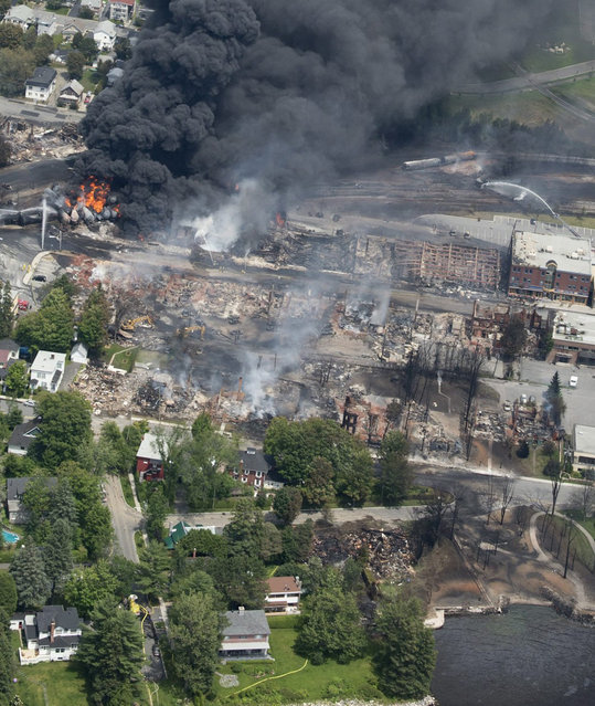 Destruction in Lac-Megantic cuts from the railyard to the waterfront, following a derailment and fire on July 6, 2013. (Photo by Paul Chiasson/AP Photo/The Canadian Press)