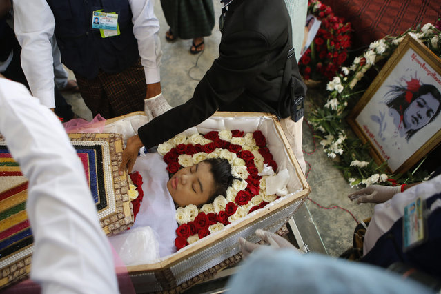 Mya Thwet Thwet Khine, lies in a coffin during her funeral in Naypyitaw, Myanmar, Sunday, February 21 2021. Mya Thwet Thwet Khine was the first confirmed death among the many thousands who have taken to the streets to protest the Feb. 1 coup that toppled the elected government of Aung San Suu Kyi. The woman was shot on Feb. 9, two days before her 20th birthday, at a protest in the capital Nayptitaw, and died Friday. (Photo by AP Photo/Stringer)