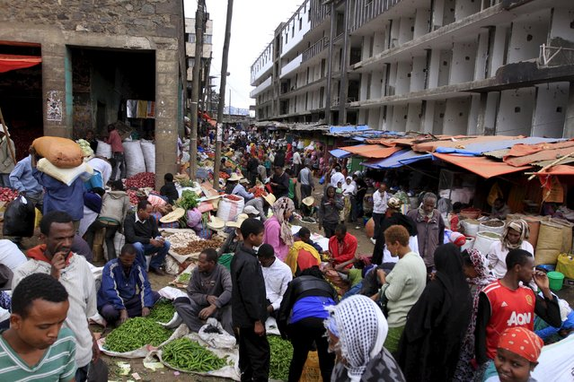 People buy vegetables at a busy market in Mercato, Addis Ababa December 15, 2015. (Photo by Tiksa Negeri/Reuters)
