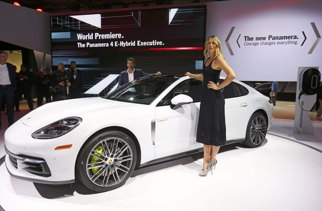 Tennis star Maria Sharapova (R) and actor Patrick Dempsey pose with the car as Porsche introduces the new 2017 Porsche Panamera executive hybrid at the 2016 Los Angeles Auto Show in Los Angeles, California, U.S November 16, 2016. (Photo by Mike Blake/Reuters)