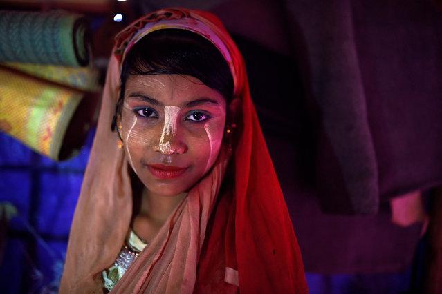 "A Rohingya refugee girl named Senuara Begum, aged 14, poses for a photograph as she wears thanaka paste at Jamtoli camp in Cox's Bazaar, Bangladesh, April 1, 2018. ""I like the makeup"", said Senuara. (Photo by Clodagh Kilcoyne/Reuters)"
