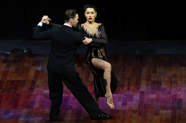 Dmitry Vasin and Sagdiana Khamzina, representing Moscow, Russia, dance during the Stage style final round at the Tango World Championship in Buenos Aires, Argentina on August 23, 2018. (Photo by Marcos Brindicci/Reuters)