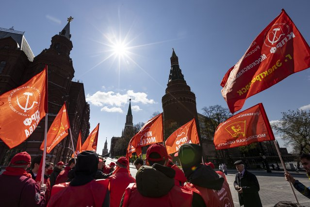 Communists party supporters gather with red flags to mark Labour Day, also knows as May Day near Red Square in Moscow, Russia, Saturday, May 1, 2021. (Photo by Alexander Zemlianichenko/AP Photo)