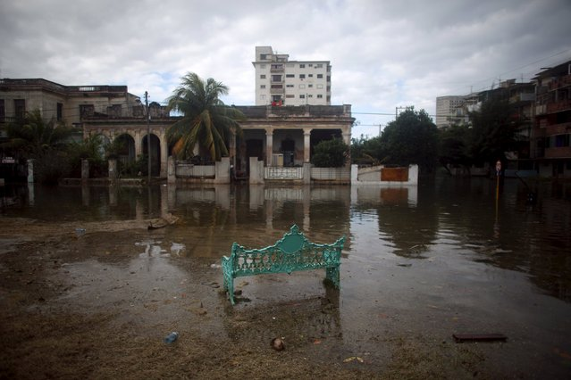 A park bench is seen in a flooded area in Havana, January 23, 2016. (Photo by Alexandre Meneghini/Reuters)
