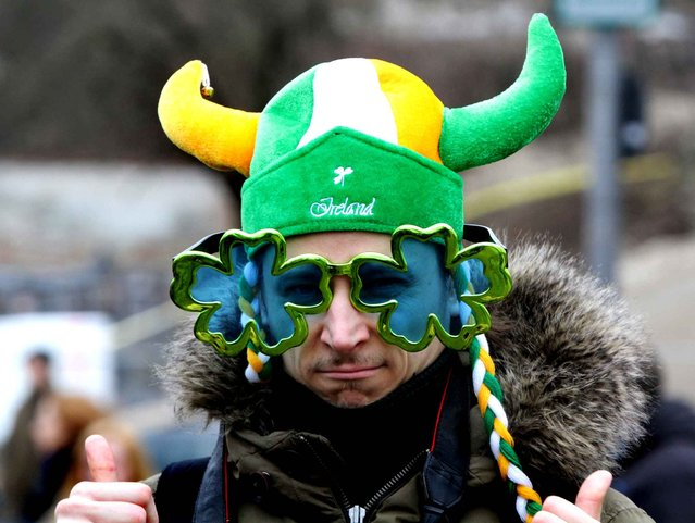 Resident of Vilnius celebrates the Irish festivity Saint Patrick's Day in Vilnius, Lithuania, on March 14, 2015. (Photo by Petras Malukas/AFP Photo)
