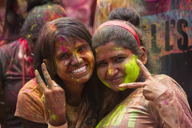 Malaysian-Indian women pose for a photo during the religious spring festival Holi in Kuala Lumpur, Malaysia on Saturday, March 21, 2015. (Photo by Joshua Paul/AP Photo)