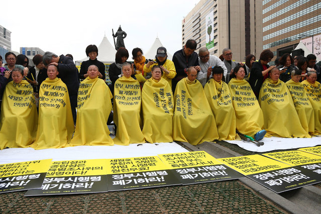 Relatives of missing loved ones in the Sewol ferry sinking having their heads shaved during a protest on Gwanghwanmun Square in Seoul, South Korea, 02 April 2015. Relatives took part in a protest demanding the vessel's recovery and the truth behind the accident on 16 April 2014, which left more than 300 dead. (Photo by Yang Ji-Woong/EPA)