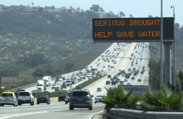 A digital traffic sign usually used for commuter travel information informs travelers southbound on interstate highway 5 to conserve water as they pass through Del Mar, September 10, 2014. (Photo by Mike Blake/Reuters)