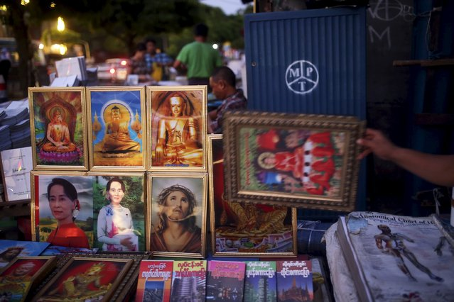 Pictures of Aung San Suu Kyi are offered for sale next to those of Jesus Christ and Buddha in downtown Yangon April 4, 2015. With an historic general election just seven months away, Myanmar opposition leader and Nobel laureate Aung San Suu Kyi is locked in a high-stakes showdown with a military-backed government she says isn't interested in reform. (Photo by Reuters/Minzayar)