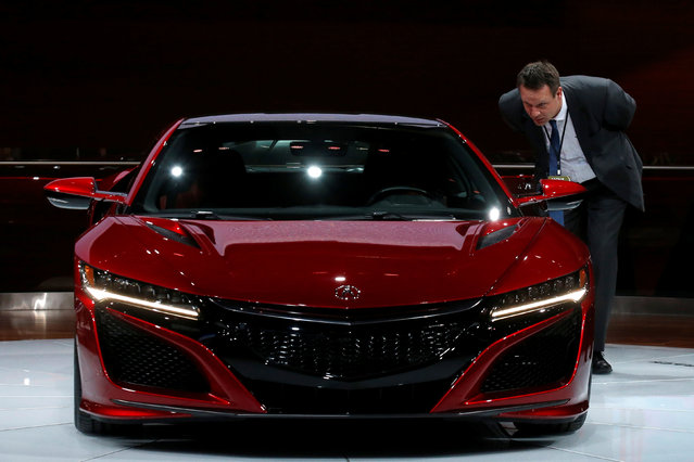 A man looks at an Acura NSX displayed during the North American International Auto Show in Detroit, Michigan, U.S., January 10, 2017. (Photo by Brendan McDermid/Reuters)