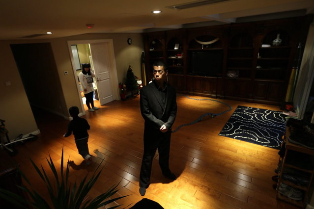 Student Ding Kun stands guard in a villa during field training for Tianjiao Special Guard/Security Consultant on the outskirts of Beijing December 12, 2013. (Photo by Jason Lee/Reuters)