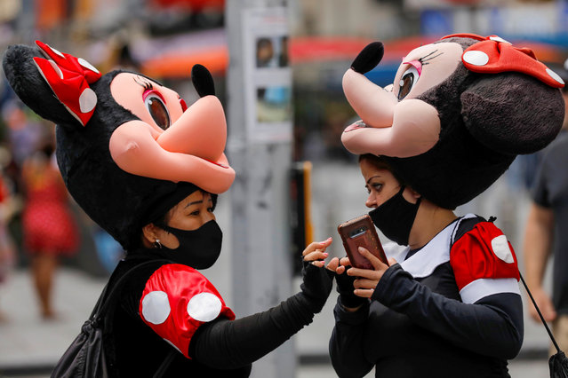 Two women wear masks while dressed as Minnie Mouse in Times Square during the outbreak of the coronavirus disease (COVID-19) in Manhattan, New York City, U.S., August 2, 2021. (Photo by Andrew Kelly/Reuters)
