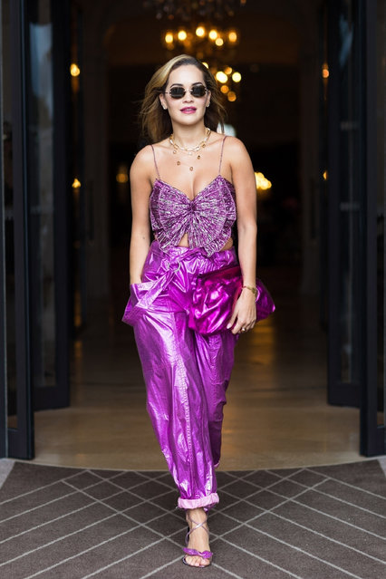 """Rita Ora looks striking in a purple ensemble as she struts out of her hotel in Paris, France on August 9, 2021. Rita is in good spirits as """"The Voice Australia"""" breaks audience records thanks to her on the show. (Photo by Backgrid USA)"""