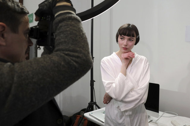 A model is photographed backstage before the Jasper Conran Autumn/Winter 2019 fashion week runway show in London, Saturday, February 16, 2019.(Photo by Grant Pollard/Invision/AP Photo)