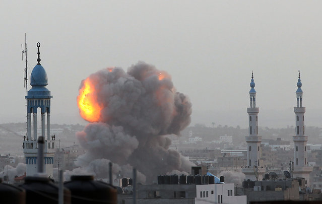 A fire ball rises as the Israeli air force carries out a raid over Gaza City on November 17, 2012, for the fourth consecutive day. (Photo by Majdi Fathi/AFP Photo)