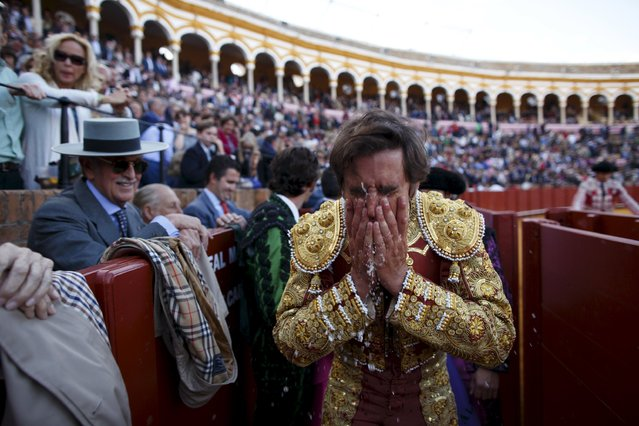 Spanish matador Eduardo Davila Miura washes his face with water after killing a bull during a bullfight at The Maestranza bullring in the Andalusian capital of Seville, southern Spain April 26, 2015. (Photo by Marcelo del Pozo/Reuters)