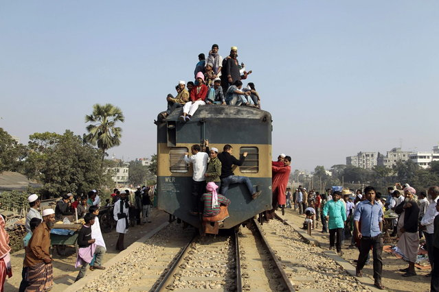 Bangladeshi Muslim devotees head to their homes in an over-crowded train after attending three-day Islamic Congregation on the banks of the River Turag in Tongi, 20 kilometers (13 miles) north of the capital Dhaka, Bangladesh, Sunday, January 26, 2014. (Photo by A. M. Ahad/AP Photo)