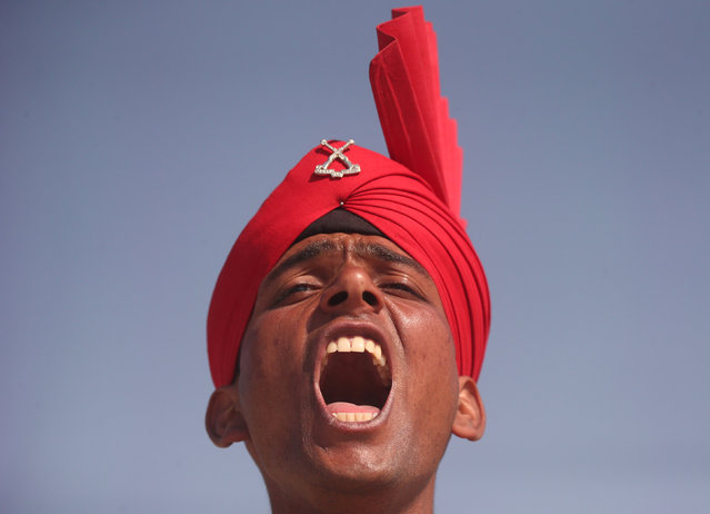 An Indian army recruit wearing his ceremonial headgear shouts a command during his passing-out parade in Rangreth on the outskirts of Srinagar March 9, 2019. (Photo by Danish Ismail/Reuters)