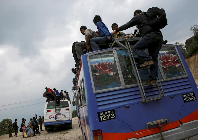 People sit atop buses as they leave Kathmandu following Saturday's earthquake in Nepal, April 28, 2015. (Photo by Danish Siddiqui/Reuters)