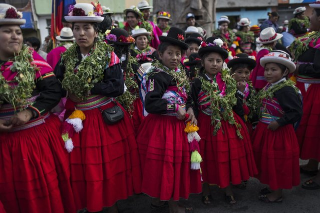 """In this January 29, 2017 photo, dancers wait their turn to perform during Virgin of Candelaria celebrations in Puno, Peru. Anthropologist Henry Flores, who has studied indigenous dances in the town of Puno, said """"There's always been a lack of respect for the countryside. But when the villagers participate, they are saying, """"I am present' and the people from the city are only spectators"""". (Photo by Rodrigo Abd/AP Photo)"""