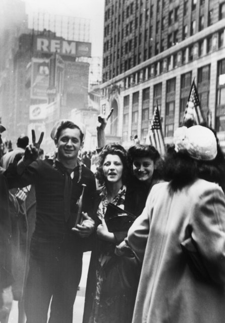 Americans take to the streets on hearing the news of Germany's unconditional surrender. (Photo by Hulton Archive/Getty Images)