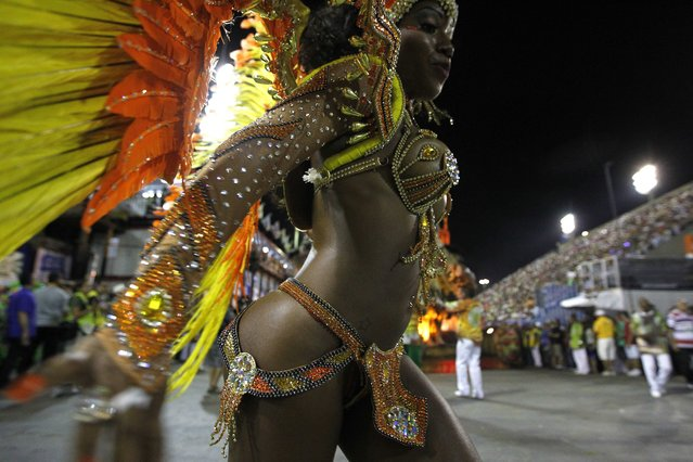 The Samba school Imperio da Tijuca performs during the first day of the parade in the sambodromo during the carnival of Rio de Janeiro, Brazil, 02 March 2014. (Photo by Marcelo Sayao/EPA)