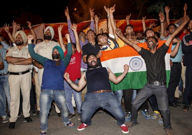 Cricket, India vs Australia, World Twenty20 cricket tournament, Chandigarh, India on March 27, 2016. Fans celebrate after India beat Australia. (Photo by Ajay Verma/Reuters)