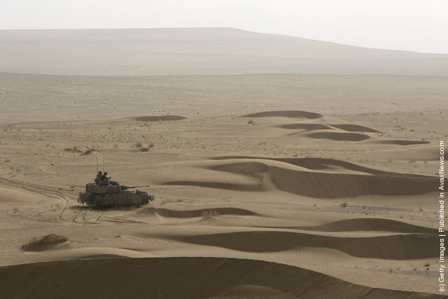 British Soldier from the B Squadron of The Light Dragoons Regiment drive on their Scimitar tank