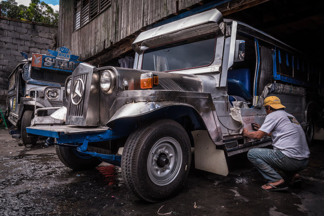Roy Motors in Santa Cruz, Metro Manila. 56-year-old Nonoy has worked for the company for over a decade. He is currently painting an older vehicle for one of his customers. It's hard to change jobs, he says – he simply wouldn't know what to apply for if the phaseout happens. (Photo by Claudio Sieber/Barcroft Media)