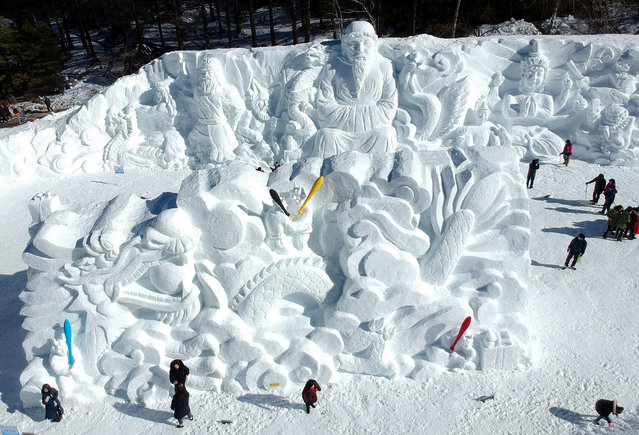 Visitors view large snow sculptures at the Mount Taebaek Snow Festival in the city of Taebaek, South Korea, 18 January 2018. The festival opened on 18 January and will run until 03 February 2019. (Photo by EPA/EFE/Yonhap)