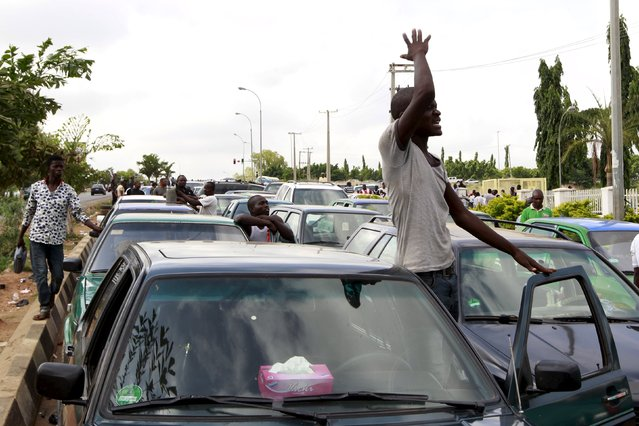 A motorist reacts outside the NNPC mega petrol station Abuja, Nigeria May 25, 2015. (Photo by Afolabi Sotunde/Reuters)