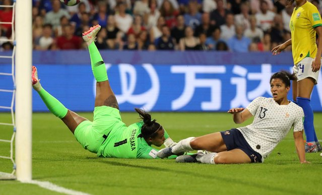 France's forward Valerie Gauvin (R) scores a goal during the France 2019 Women's World Cup round of sixteen football match between France and Brazil, on June 23, 2019, at the Oceane stadium in Le Havre, north western France. (Photo by Lucy Nicholson/Reuters)
