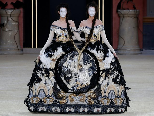 Models present creations by designer Guo Pei as part of her Haute Couture Fall/Winter 2019/20 collection show in Paris, France, July 3, 2019. (Photo by Regis Duvignau/Reuters)