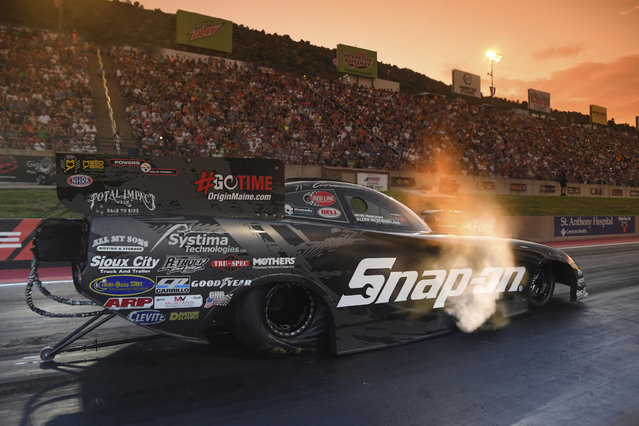 In this photo provided by the NHRA, Cruz Pedregon drives in Funny Car qualifying at the Dodge Mile-High NHRA Nationals drag races at Bandimere Speedway on Friday, July 19, 2019, in Morrison, Colo. (Photo by Jerry Foss/NHRA via AP Photo)