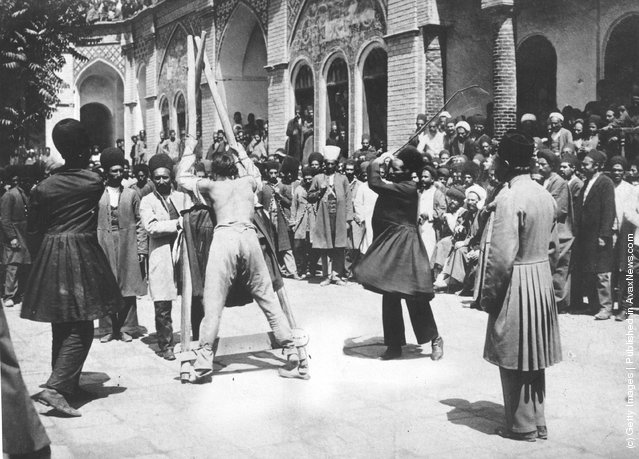 1910: A criminal is publicly whipped in the street in Persia